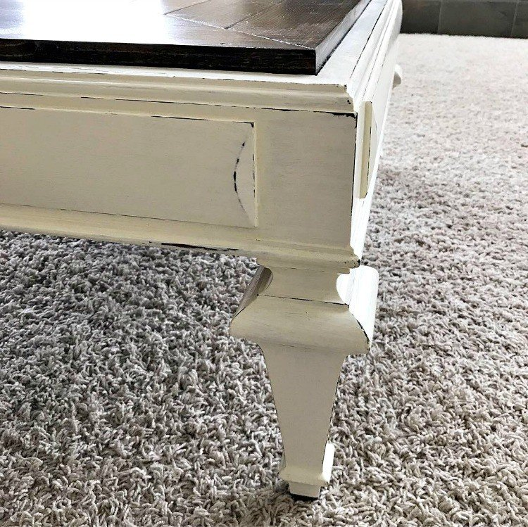 Table Leg with dark stain base, painted over with white paint, then distressed. #AbbottsAtHome