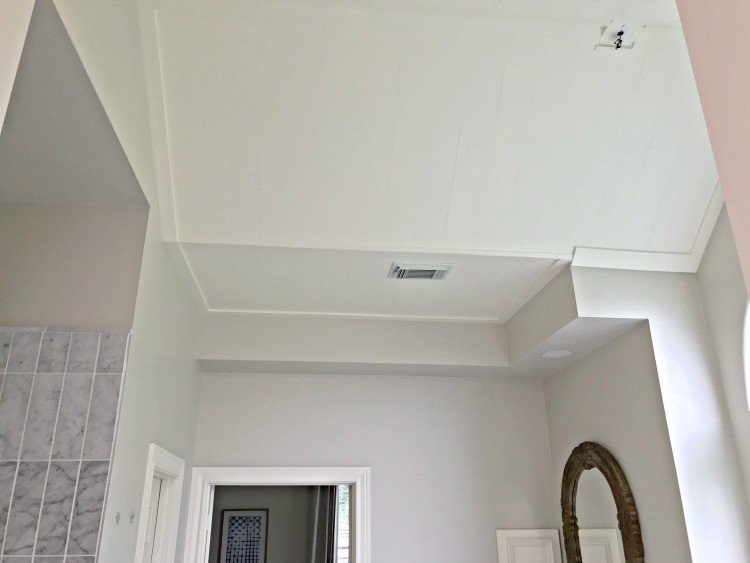 "I love this DIY 1/4"" Plywood Plank Ceiling Installation. It's more subtle than faux shiplap since the lines are caulked. But so pretty! #AbbottsAtHome #Ceiling #Planks #PlankCeiling #FauxShiplap"