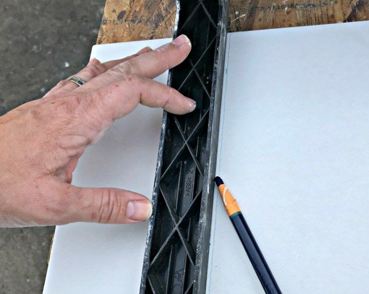 Use a China Marker to make cutting guides on tiles.