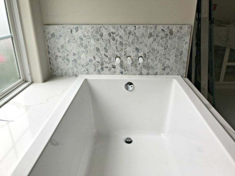 I'm so glad I decided to go for this marble mosaic tile bathroom design! How pretty is that MSI Calacata Blanco Marble tile?! #AbbottsAtHome #MosaicTile #MarbleTile #BathroomTile