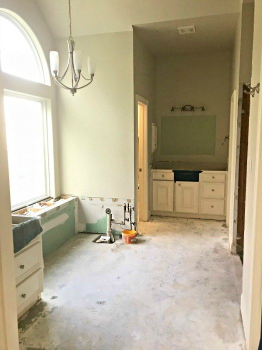 Her Master Bathroom Demo is done. I love seeing the new framed in tub and prep work on the shower. This bathroom makeover will be beautiful! #DemoDay #BathroomDemo #HomeRemodeling BathroomReno #AbbottsAtHome