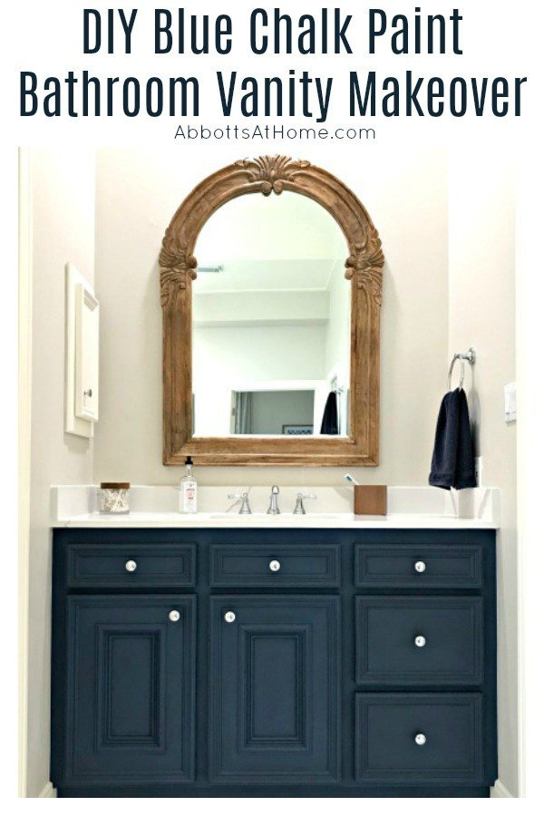 Pottery Barn wood mirror over blue bathroom vanity with white quartz countertop. DIY Napoleonic Blue Bathroom Vanity Makeover. #AbbottsAtHome #ChalkPaintMakeover #BathroomCabinets #BathroomVanity #BathroomRemodel