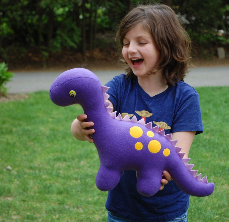 Kid with dinosaur