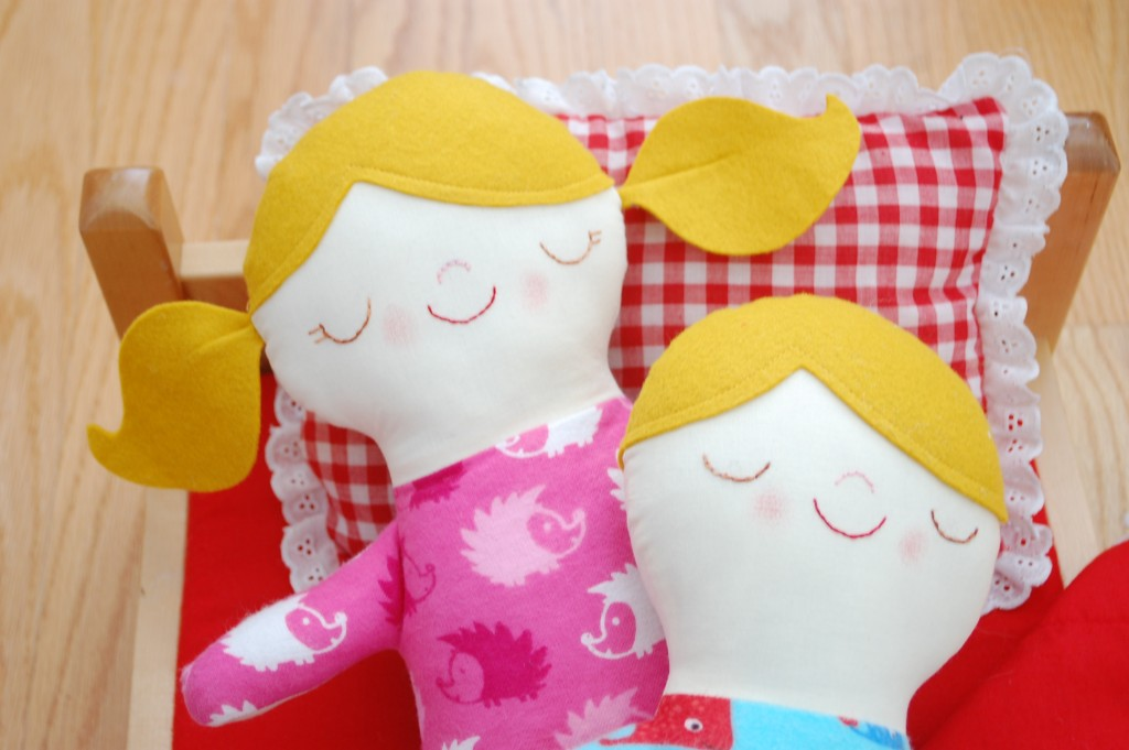boy and girl dolls asleep
