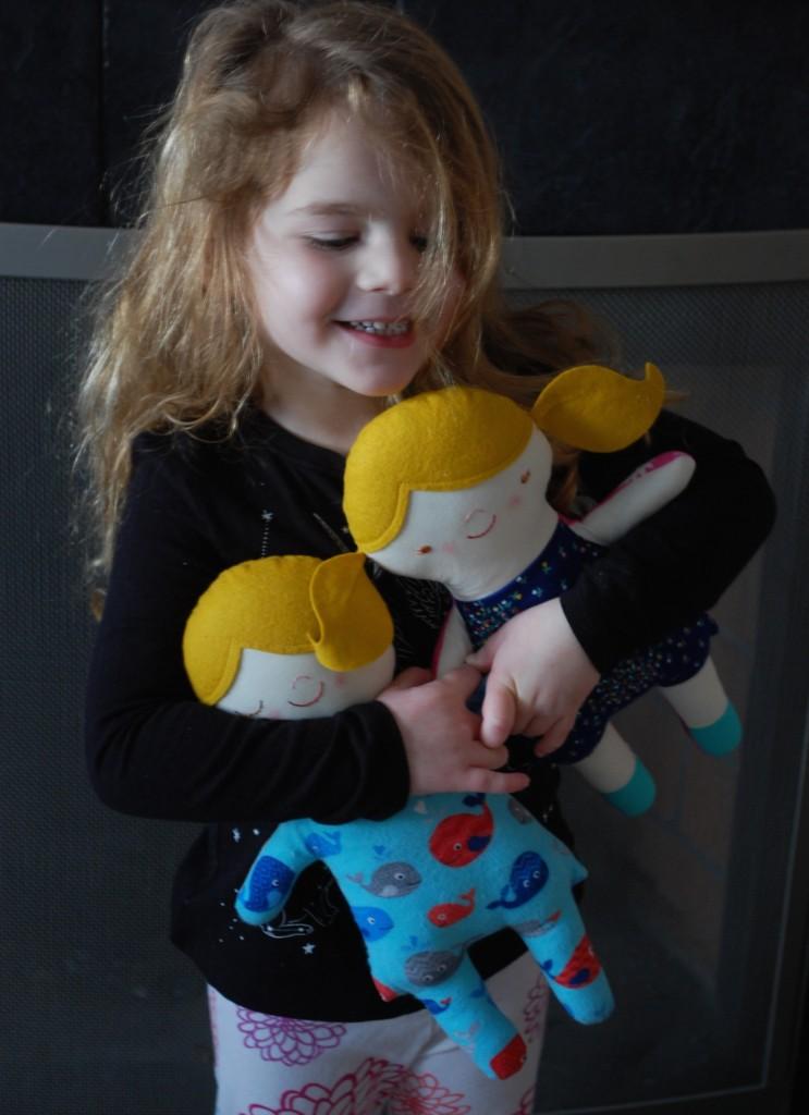 Girl hugging dolls