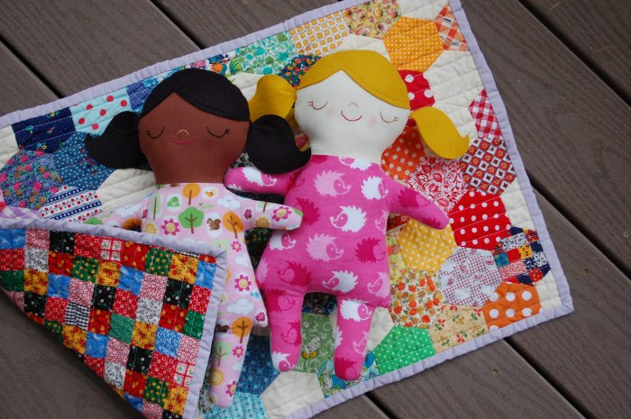 Dolls on doll quilt