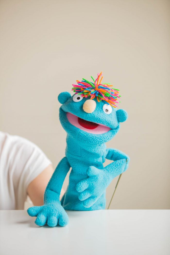 blue puppet with an open mouth