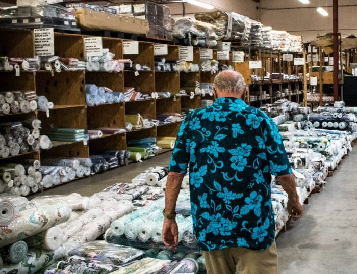 Walter Hoffman walking in the Hoffman Fabrics warehouse