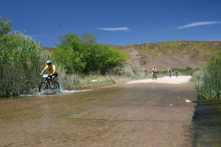 ABC bike and hike challenge - Bikers crossing a flooded road