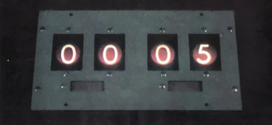 The Count-Down clock. Set at the time limited of the programme, it counts back to zero; is a cold reminder of the time left to run. With only five seconds to go, it flashes red.