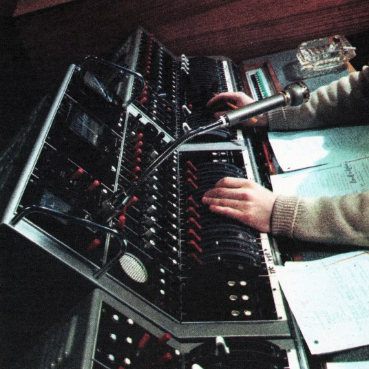 A Sound Console. The supervisor has an ear to everything; can mix, distort, control the flow from tape and gram decks, and 26 microphones on the floor or in separate sound studios. Microphone on goose-neck is for 'talk back' to boom operators, Director, sound sources.