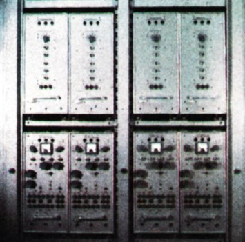 Light drawers serving a studio's 'eyes'. At the top are four camera control units; below their four power units.