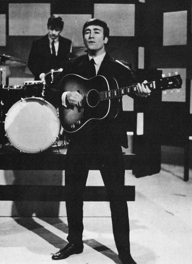 Lennon on guitar