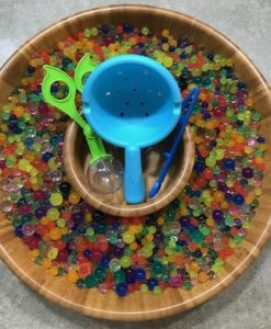 water marble sensory activity with fine motor tools