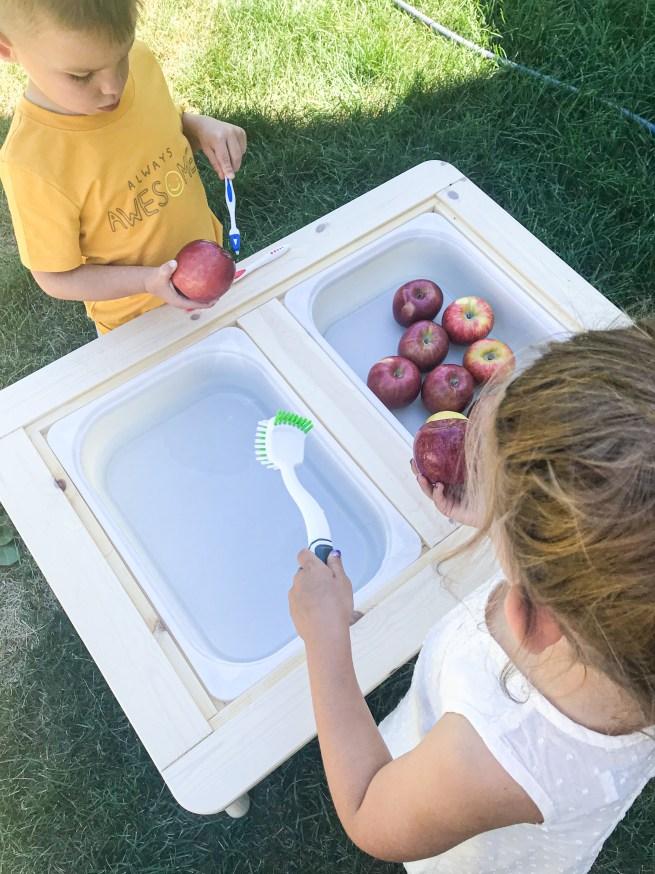apple washing sensory play