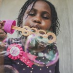 Canva - Girl Blowing Bubbles