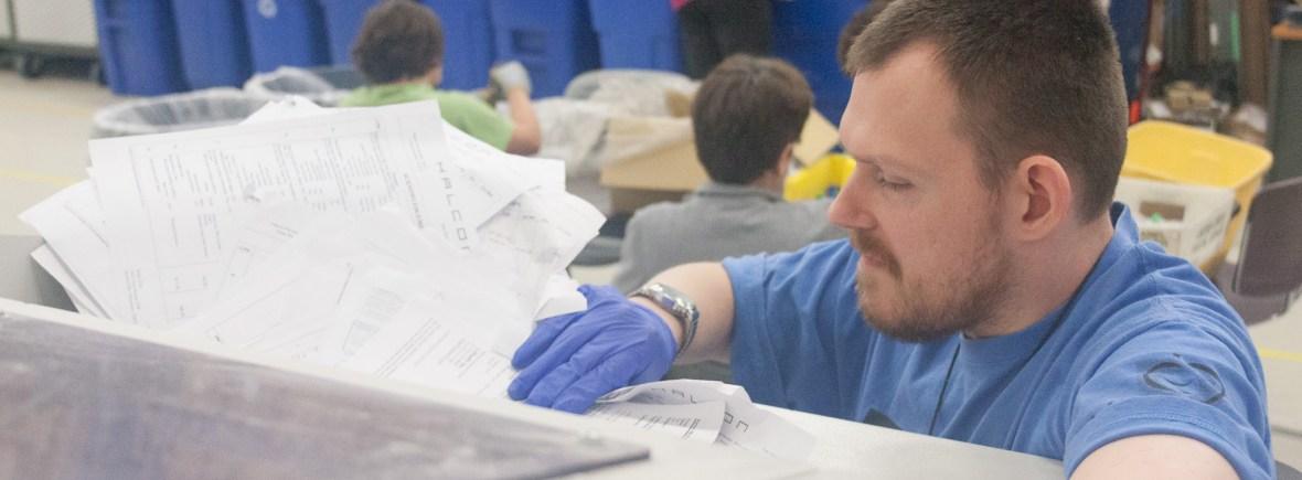 ABC worker in shredding.