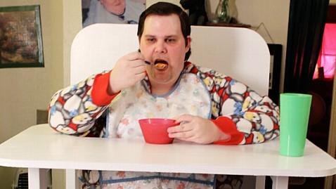 adult baby high chair hanging domayne cleared of fraud still getting social security checks stanley thornton jr eats his dinner in personalized highchair while bib and pajamas at home redding calif