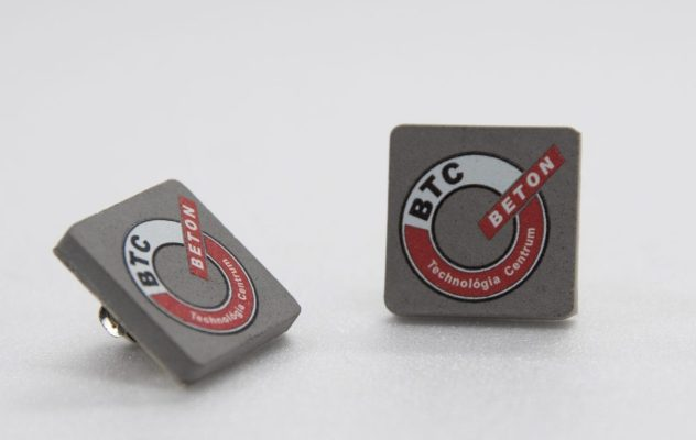 Colored printed concrete pin for cement techology company's employees