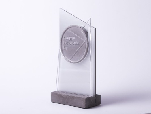 Unique custom made trophy design made of concrete and acrylic glass