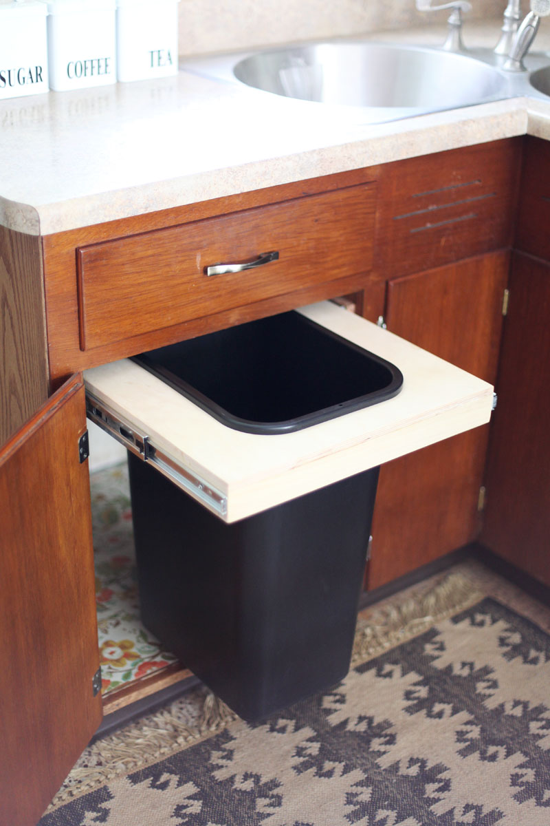kitchen trash can pull out what i use to unclog my sink convert a cabinet into bin beautiful mess