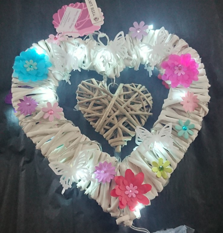 Lit heart with paper flowers