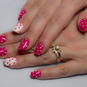 Pink polka dot and heart nail polish