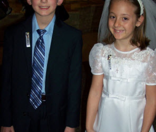 Boy And Girl Celebrating First Holy Communion