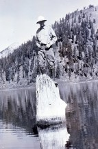a-park-ranger-demonstrates-the-buoyancy-of-the-old-man-of-the-lake-undated-c-1930
