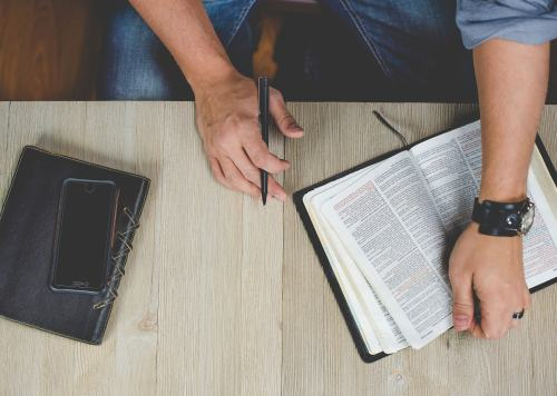 Man reading bible picture.