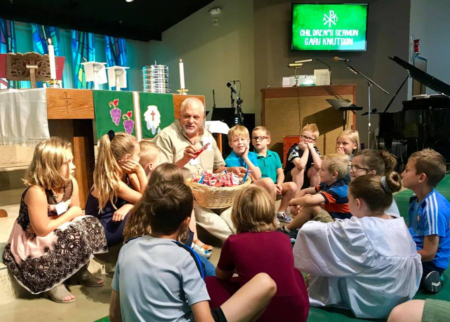 Youth Director Gary with Children during Children's Sermon   Abiding Grace Lutheran Church