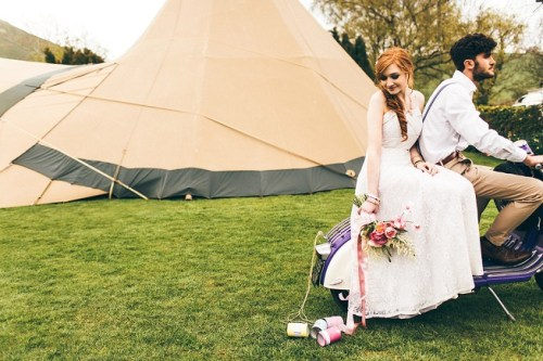 vintage wedding dress on a vespa with a tipi