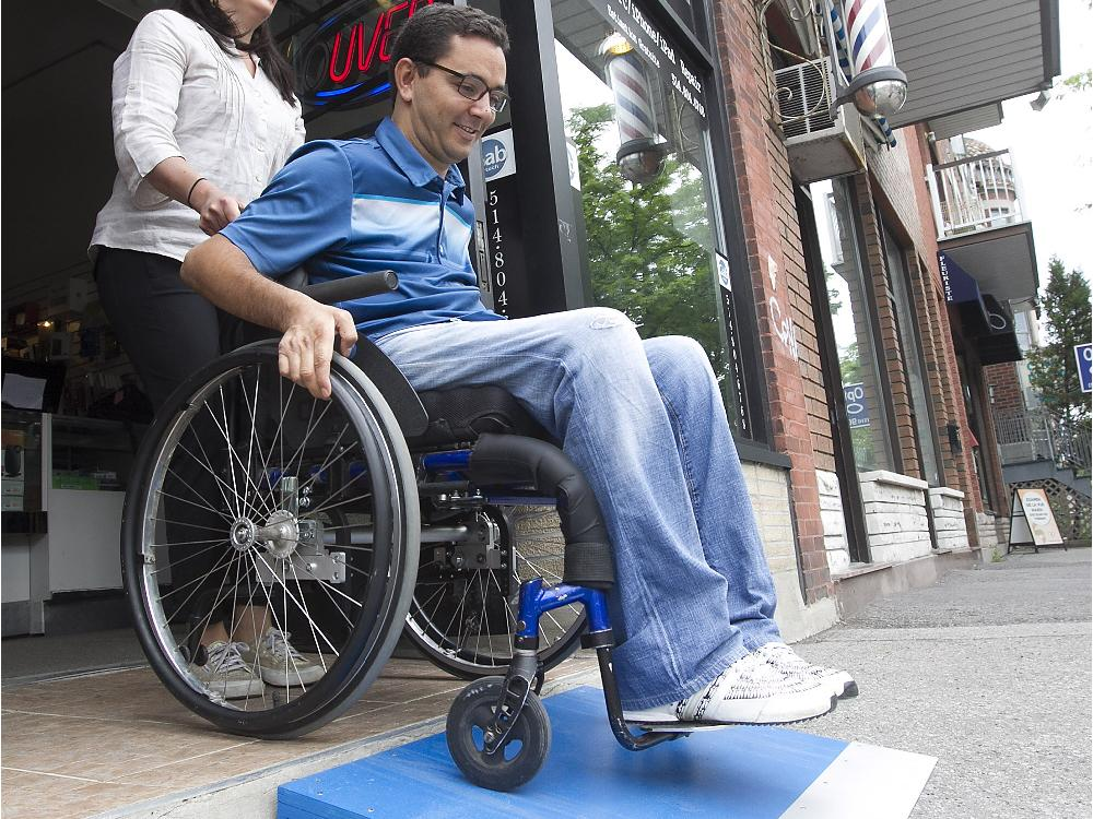 wheelchair man small tables and chairs with disability building free ramps for montreal businesses