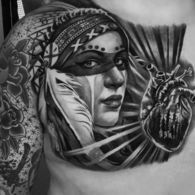 indian-girl-headdress-heart-chest-tattoo.jpg
