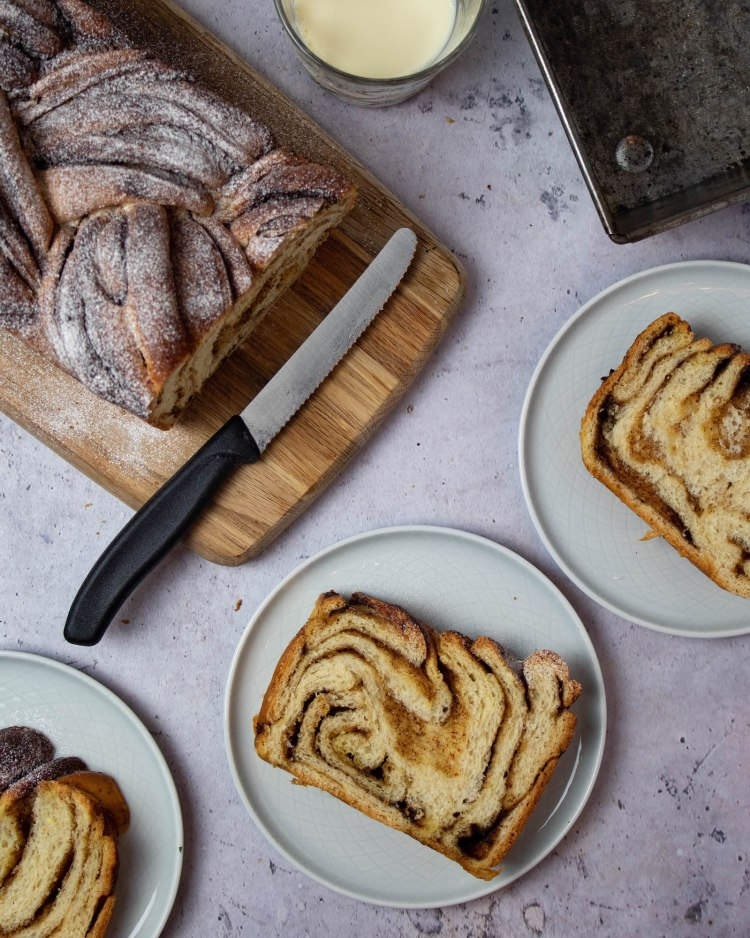 Photo of cinnamon bread slices and a cut loaf of cinnamon bread