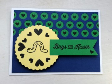 "A Bit Of Glue & Paper - card with blue, green and yellow paper, stamped smiling worm and hearts with ""Bugs and Kisses"" sentiment, die cut circles with hearts stamped inside; Color Throwdown 436 - Vancouver BC"