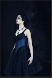 Odile: Couture corset bodice with draped tulle, feather trim, and hand applied braid. Separate tulle skirt.