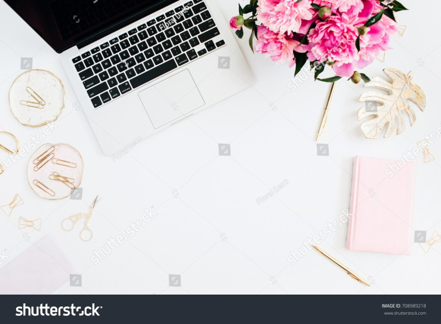 stock-photo-flat-lay-home-office-desk-female-workspace-with-laptop-pink-peonies-bouquet-golden-accessories-708989218