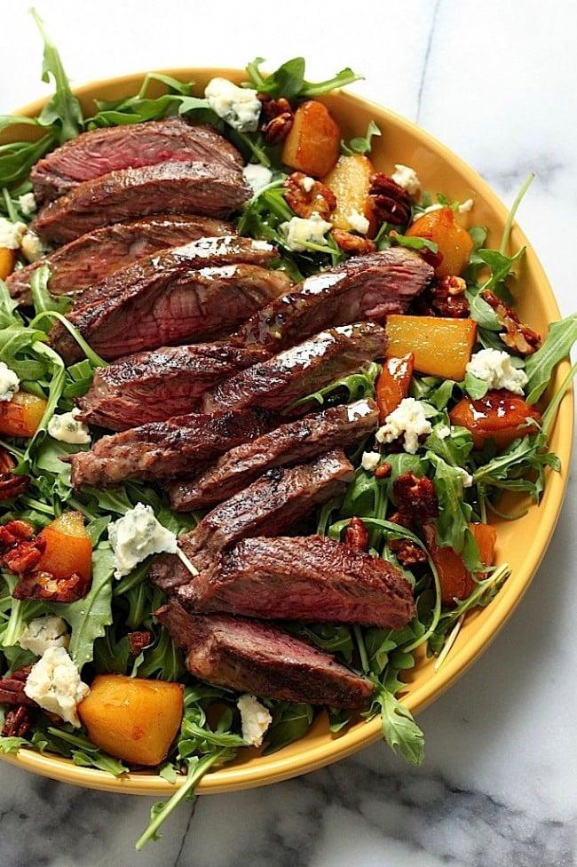 Arugula Skirt Steak Salad with Caramelized Pears Pecans and Gorgonzola