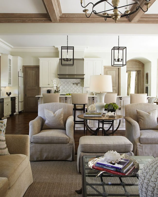 How to decorate with neutral colors: this neutral color scheme makes this living and dining room feel warm and inviting. The griege chairs and carpets bring a consistency throughout the room.