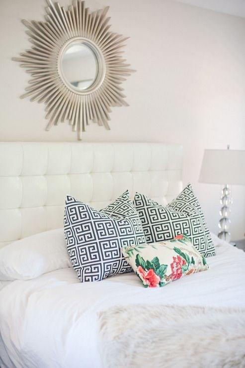 Add a sunburst mirror above the bed