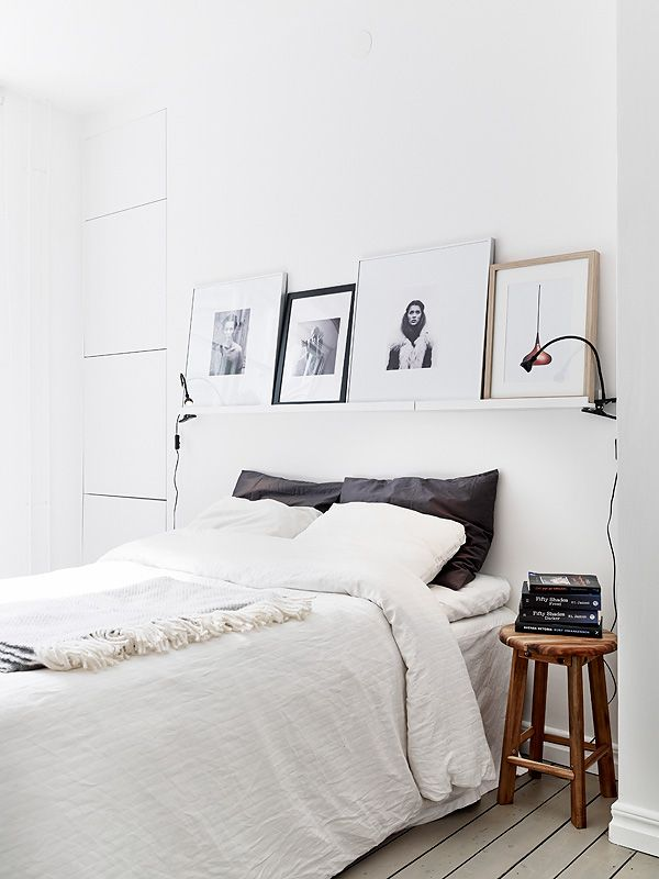 Place a shelf above the bed for a place to display things