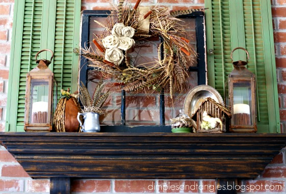 A beautiful faux fall mantel with a pop of green in these vintage shutters.