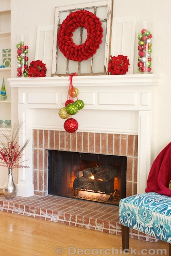 Christmas mantels - pom pom wreath with red, green, and gold accents - Christmas Mantel Fireplace Makeover Decor Chick