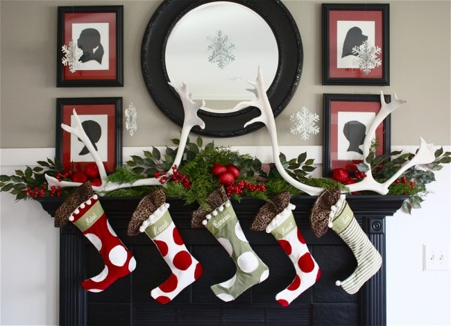 Christmas mantels - polka dot stockings and holly berry garland - Christmas Mantel The Yellow Cape Cod