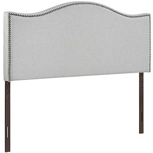 The unique shape of this headboard is sure to make a statement! This sky grey color works beautifully with the black and silver nail heads. We've rounded up 15 of the BEST affordable headboards under $300!! ~ via A Blissful Nest