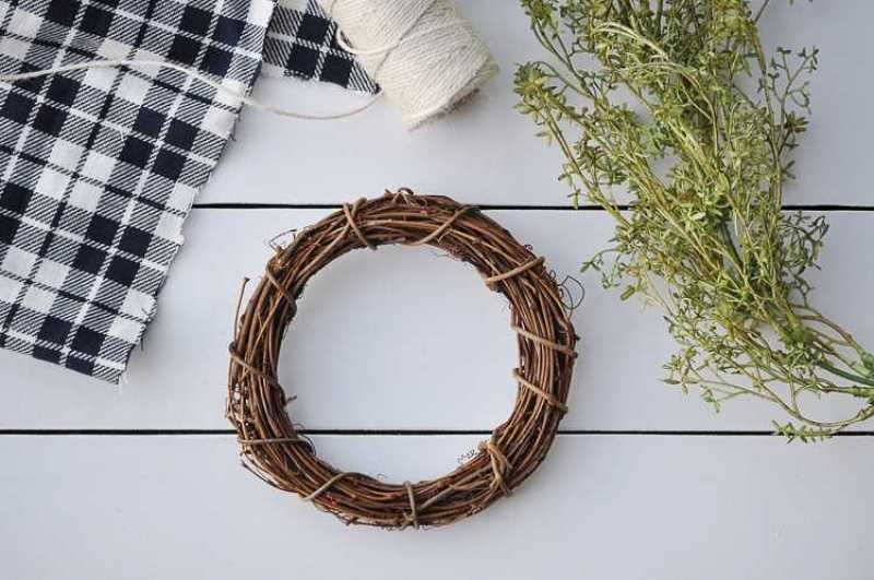 This fall farmhouse mini wreath is a quick and simple project to add a little fall beauty to your homes decor. See more at https://ablissfulnest.com #Fall #FarmhouseDecor #FallWreath