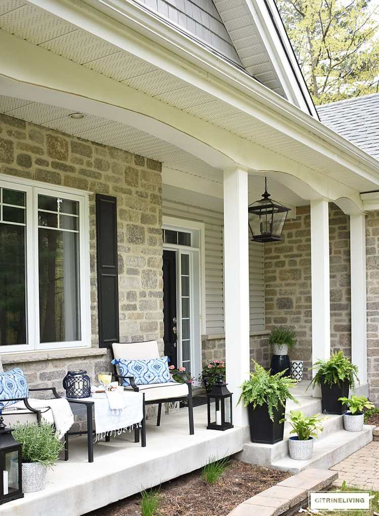 Just adore this extended porch with it's blue and white details from Citrine Living! #spring #springporch #springdecorating #springfrontporch