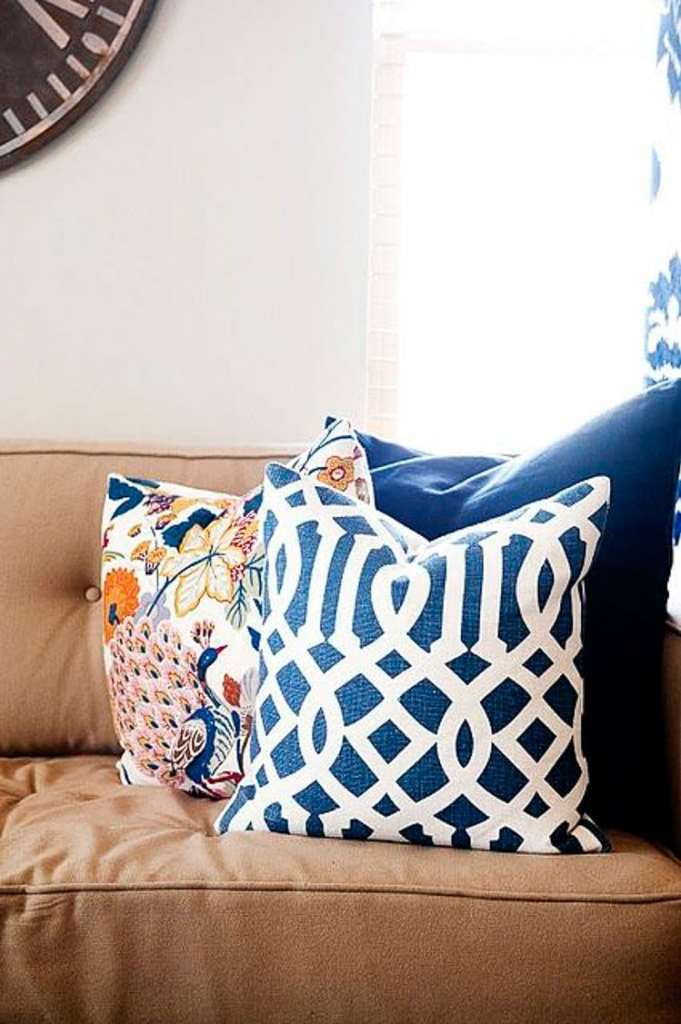 These three throw pillows are all different patterns, but all have matching elements that brings a cohesive design to the look of the room