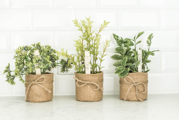 Love these cute faux herb baskets for the kitchen! #ad #AthomeStores #springdecorating #springdecoratingideas #kitchen #springkitchen #whitekitchen